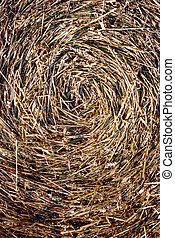 Close-up of straw bales. Spiral texture.