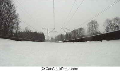 train in winter, view from below