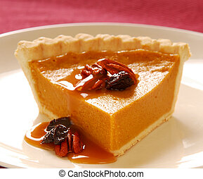 Pumpkin pie with pecans - Freshly baked pumpkin pie with...