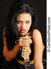 Sexy latino woman with a guitar