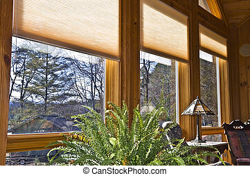 Window Blinds - Large windows in a house showing the window...
