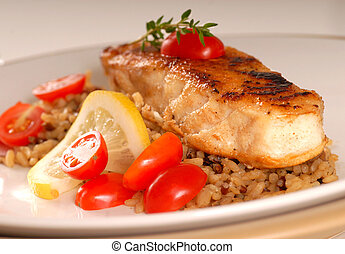 Halibut seared on a bed of brown rice - Fresh halibut seared...