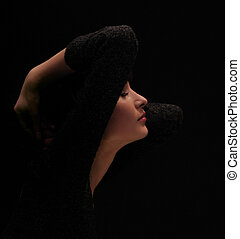 black on black - girl in black on a black background