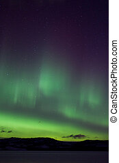 Colorful northern lights aurora borealis substorm on dark...