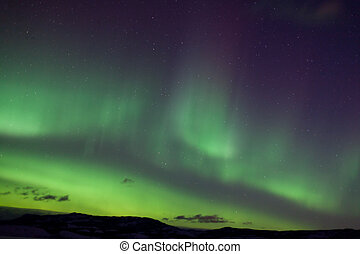 Colorful northern lights (aurora borealis) substorm on dark...
