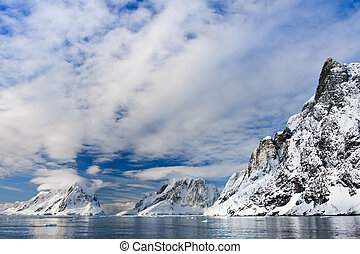 Beautiful snow-capped mountains against the blue sky in...
