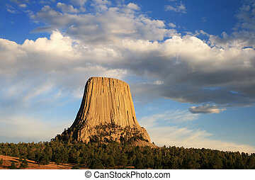 devils tower national monument in wyoming with late...
