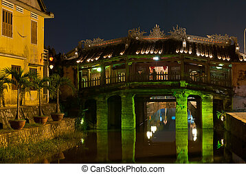Japanese Covered Bridge by night, Hoi An, Vietnam - The...