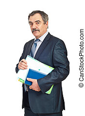 Middle aged business man holding folders and personal agenda...