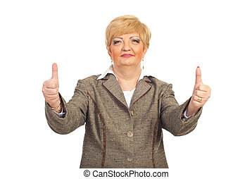 Mature business woman giving thumbs up with both hands...