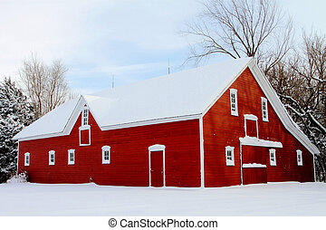 red barn covered with snow - historic Mennonite barn, North...