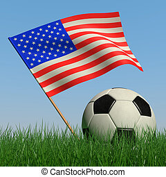 Soccer ball in the grass and the flag of USA against the...