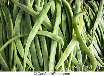 Runner Beans - A display of runner beans outside a...