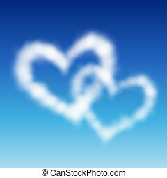 Two heart shaped clouds in the blue sky. Valentine`s day...