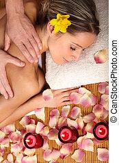massage - Beautiful young woman getting a massage