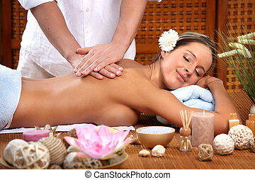 massage - Beautiful young woman getting a massage