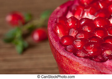 Pomegranate close-up. - Pomegranate close-up on a brown...