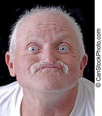 Old man with a funny face on a black background