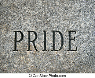 Pride - the word pride carved onto a granite cobble stone