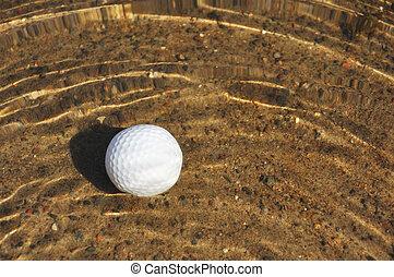 Golf Ball in a Water Hazard - Golf Ball on Sandy Bottom of a...