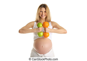 Pregnant woman involved in fitness dumbbells made from...