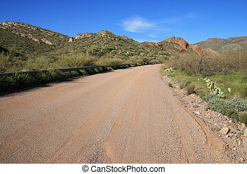 Arizona dirt road - Arizona rural dirt road with distant...