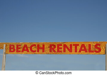 Beach Rentals Sign - A wooden hand painted sign saying Beach...