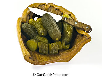 Pickled cucumbers on wooden plate - white background