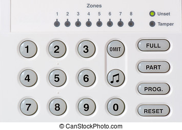 Alarm Keypad - Macro photo of a white alarm keypad