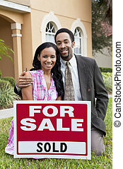 African American Couple and House For Sale Sold Sign - A...