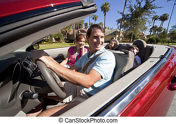 Family Driving Red Convertible Car
