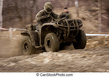 Quad competition - Man driving quad during the race among...