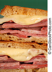 Closeup of corned beef sandwich with cheese on rye