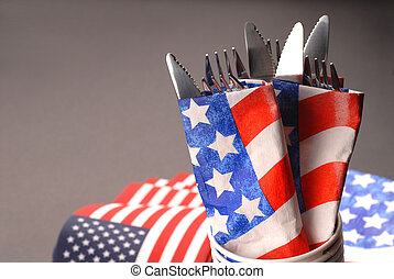 Knives and forks wrapped in a 4th of July theme