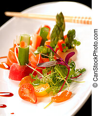 Beautiful Japanese sashimi on a white plate - Variety of...