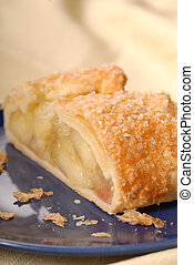 Piece of fresh apple strudel with a flaky crust