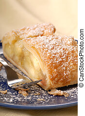 Fresh apple strudel with powdered sugar - Freshly baked...