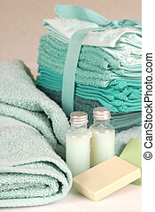 Green towels with soap and shampoo - Fresh green towels,...