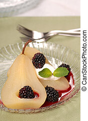 Bartlett pear poached in wine with a blackberry sauce - A...