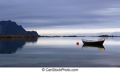 sea of tranquility - boat anchored on still water with...