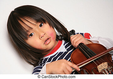 Violin child - Cute child looking at the camera with a...