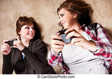 Teenagers texting - A shot of a couple of teenagers texting...