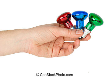 Hand hold tiny red, blue and green spot tungsten lightbulbs
