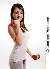 Attractive asian filipina woman lifting weights