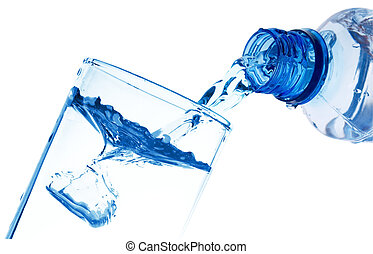 Pure water is poured from a bottle in a glass