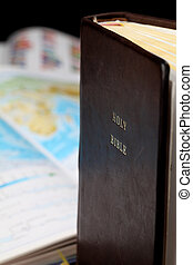 World Missions - Holy Bible and a world map in the...