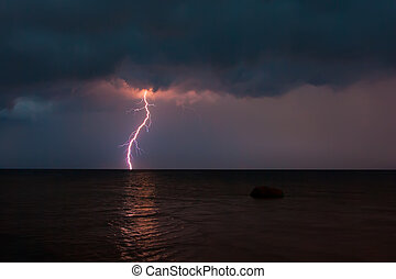 Storm over the sea with lightning close up