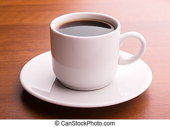 Dark coffee in white cup - Hot coffee on a table