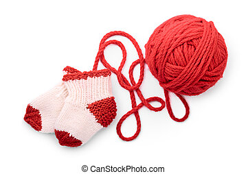 Isolated red skein and knitted socks - Socks and skein on a...