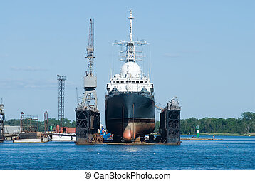 A ship in Baltiysk dry dock - Science ship for repairs in...